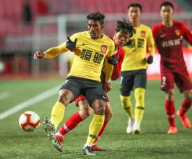China title race poised for last-day drama as Paulinho hits brace. AFP