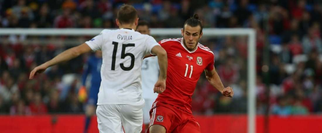 Gareth Bale dribbles round Georgias Valeri Gvilia during the World Cup qualifier in Cardiff on October 9, 2016