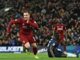 Liverpool pensa em vender Origi e Shaqiri. AFP
