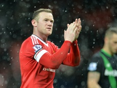 Manchester Uniteds English striker Wayne Rooney applauds at the end of the English Premier League football match between Manchester United and Stoke City at Old Trafford in Manchester, north west England, on February 2, 2016