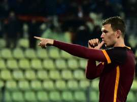 Romas forward Edin Dzeko celebrates after scoring a goal during the Serie A football match between Carpi and AS Roma at Alberto Braglia Stadium in Modena on February 12, 2016