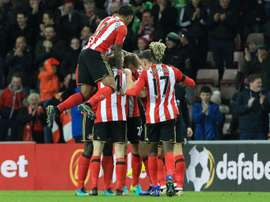 Sunderland players celebrate Robert Huth's own-goal. AFP