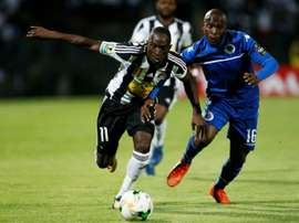 SuperSport United's Aubrey Bodiba and TP Mazembes' Adam Traore challenge for the ball. AFP