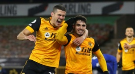 Pedro Neto (right) scored a late winner for Wolves over Chelsea. AFP