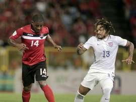 US Jermaine Jones (R) challenges Trinidad & Tobagos Andre Boucaud during the FIFA WC Russia 2018 CONCACAF football qualifier in Port of Spain, on November 17, 2015
