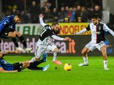 Higuain and Dybala helped Juve to victory at Atalanta. AFP