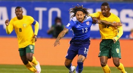 Jermaine Jones of the United States fends off Seinard Bowens of St. Vincent and the Grenadines during a World Cup qualifying match at Busch Stadium on November 13, 2014 in St. Louis, Missouri