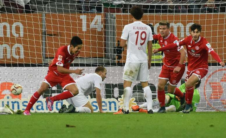 Mainz Japanese striker Yoshinori Muto (L) celebrates scoring during the German first division Bundesliga football match FC Augsburg vs FSV Mainz in Augsburg, southern Germany, on October 31, 2015