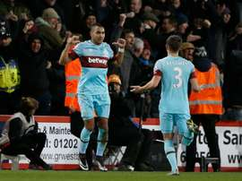 West Ham Uniteds midfielder Dimitri Payet (L) celebrates after scoring during the match between Bournemouth and West Ham United on January 12, 2016