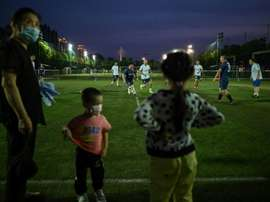 People can finally play football in Wuhan after COVID-19 restrictions were eased. AFP
