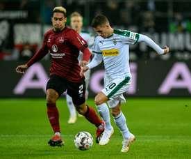 Dortmund are keen to nab a Bundesliga rivals' top man. AFP