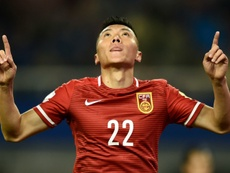 Chinas Yu Dabao celebrates a goal against Bhutan during their 2018 FIFA World Cup qualifying match in Changsha on November 12, 2015