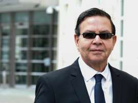 Former Honduran president Rafael Callejas leaves the Brooklyn federal court in New York, March 28, 2016 after pleading guilty to charges of racketeering conspiracy and wire fraud conspiracy in connection with the FIFA corruption scandal