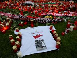 Football fans hold a vigil in memory of late Cameroonian international Patrick Ekeng. BeSoccer