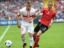 Albanias defender Ansi Agolli (right) challenges Switzerlands midfielder Xherdan Shaqiri during their Euro 2016 match at the Bollaert-Delelis Stadium in Lens on June 11, 2016