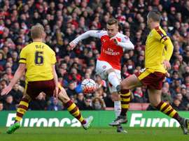 Arsenal defender Callum Chambers, 23, could be on his way to Craven Cottage. AFP