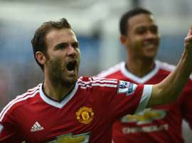 Manchester Uniteds Juan Mata (L) celebrates after scoring during the Premier League match against Swansea City at The Liberty Stadium in Swansea on August 30, 2015