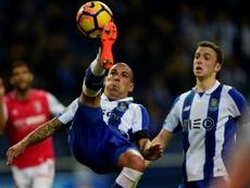 Portos Uruguayan defender Maxi Pereira(L) in action against SC Braga: his team are chasing a Champions League spot