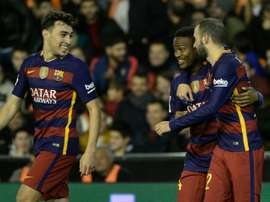 Barcelonas forward Wilfrid Kaptoum (C) celebrates his goal with Vidal Aleix and Munir El Haddadi (L) during Spanish Copa del Rey semifinal second leg match at the Mestalla stadium in Valencia on February 10, 2016