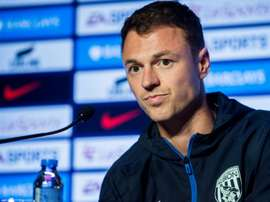 Jonny Evans' move to Manchester City is on hold. AFP