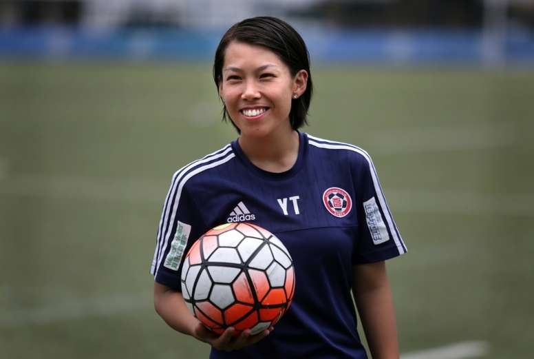 Head coach of Eastern Football club Chan Yuen-ting (C) at a team training session in Hong Kong