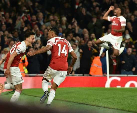 Pierre-Emerick Aubameyang celebrated with Mesut Ozil as Arsenal beat Leicester City. AFP