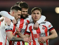 Sheff Utd won their first PL game of the season thanks to Billy Sharp (L). AFP
