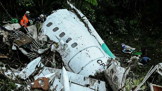 Rescuers work on recovering the bodies of victims of the LAMIA airlines charter that crashed in the mountains of Cerro Gordo, Colombia, on November 29, 2016