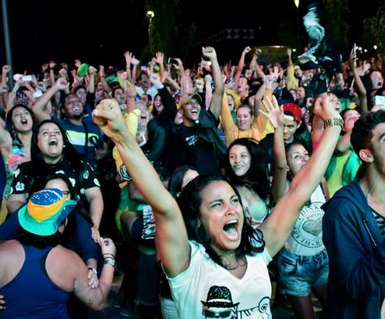 Brazil fans celebrate winning the Olympic games. AFP