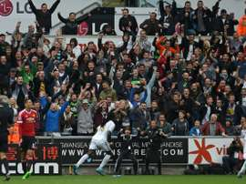 Swansea Citys striker Bafetimbi Gomis (C) celebrates after scoring during an English Premier League football match against Manchester United at The Liberty Stadium in Swansea, south Wales on August 30, 2015