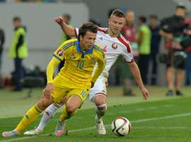 Ukraines Yevhen Konoplyanka (L) fights for the ball with Belarusian Igor Shitov during their Euro 2016 Group C match, at Arena Lviv stadium, in September 2015