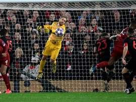 Oblak igualou um recorde de defesas no Anfield. AFP