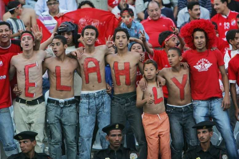 Egyptian fans celebrate before the match between Al-Ahli and Al-Zamalek football clubs in Cairo in May 2006, prior to the crowd ban