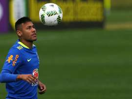 Brazilian footballer Neymar juggles with the ball during a training session ahead of the Rio Olympic Games, on July 19, 2016