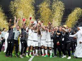 Al-Sadds players celebrate their victory in the Qatar Emir Cup