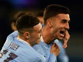 Phil Foden (left) and Ferran Torres (right)combined for Man Citys third goal. AFP