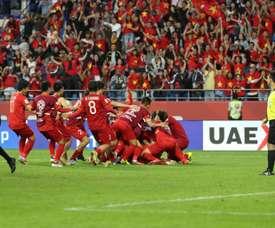 Vietnam came through a penalty shoot out to reach the quarter-finals. AFP