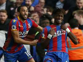 Townsend and Zaha celebrate scoring against West Ham United. AFP