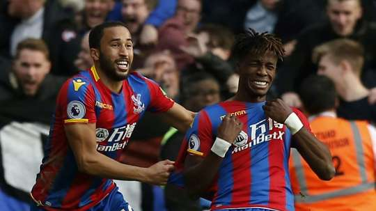 Wilfried Zaha has ended transfer speculation surrounding him. AFP