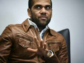 Alves neither confirmed nor denied rumours. AFP