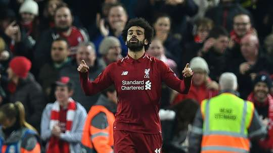 Salah takes home another trophy. AFP