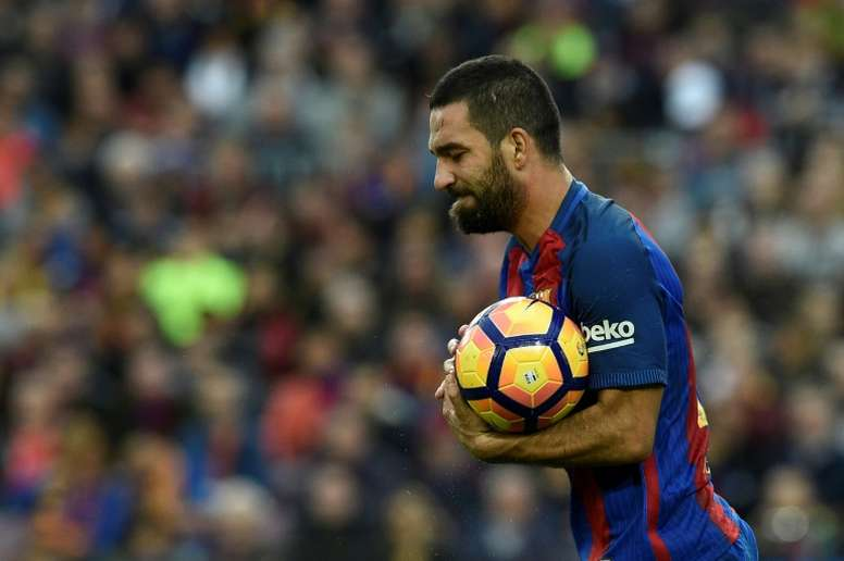 Arda Turan fired a 17-minute hat-trick against Monchengladbach. AFP