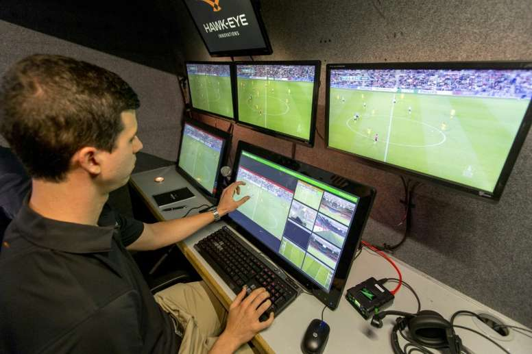 A referee looks at the broadcast of a Netherlands Cup football match on September 21. AFP