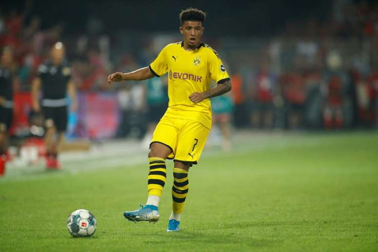 Sancho would help in improving United's attack. AFP