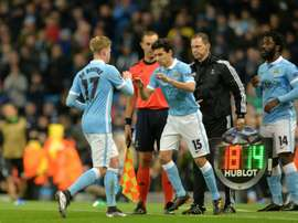 Manchester Citys Kevin De Bruyne (L) is substituted for midfielder Jesus Navas (C) during the UEFA Champions League Group D football match at the Etihad Stadium in Manchester, England, on December 8, 2015