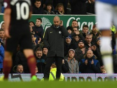 Manchester Citys manager Pep Guardiola reacts during the English Premier League football match between Everton and Manchester City at Goodison Park in Liverpool, north-west England on January 15, 2017