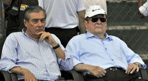 Former Conmebols president Nicolas Leoz (R) and Conmebols treasurer Romer Osuna, during a friendly football match between Bolivia and Brazil in Santa Cruz, Bolivia on April 6, 2013