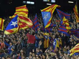 Barcelona supporters wave Catalan independece flags during the Spanish league match against SD Eibar at the Camp Nou stadium in Barcelona on October 25, 2015