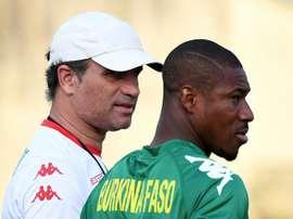 Coach Paulo Duarte speaks to Burkina Fasos Prejuce Nakoulma