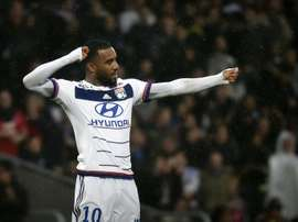 Lyons forward Alexandre Lacazette celebrates after scoring a goal during a French L1 football match against Reims on October 3, 2015, at the Gerland Stadium in Lyon